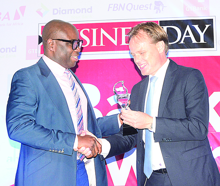 L-R Charles Aigbe ,divisional head, marketing and corporate relations UBA, receiving best Nigerian bank in sub Saharan Africa award from Edwin Visser , regional financial director, Nigeria and Ghana .