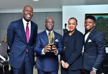 L:R: Group Head Corporate Communications, Access Bank, Plc, Amaechi Okobi; Group Managing Director/Chief Executive Officer Access Bank Plc, Herbert Wigwe, Group Head Accelerate TV, Colette Otusheso and Winner of Best Short Film/Online Video, Africa Magic Viewers' Choice Awards (AMVCA), Micheal Ama Psalmist Akinrogunde presenting the award at Access Bank Headquarters.
